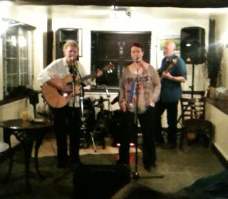 Nicky Blumfield, who was appearing at the regular open mic, playing guitar and singing – unexpectedly high! – harmonies with friend and lead singer, Jules Crow